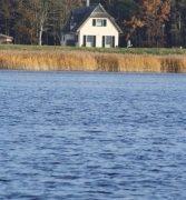 Ferienhaus Insel Rügen Reethaus Deichgraf ***** herrlicher Wasserblick.Hier sitzen Sie…